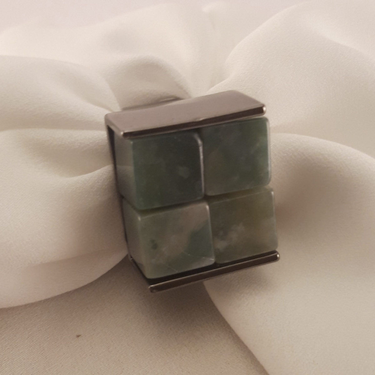 Silver Colored Ring With Green Square Stones