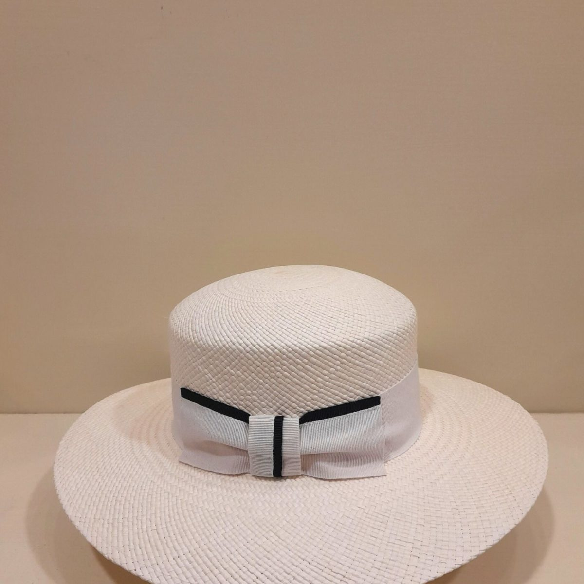Straw Hat With A White Bow And A Black Strip