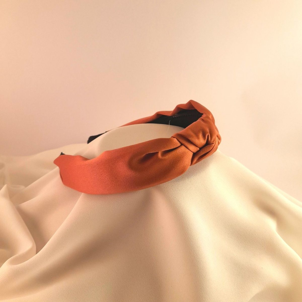 Clothing Headband With A Brick-colored Knot